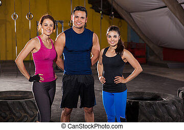 Happy crossfit instructors - Portrait of three good-looking...