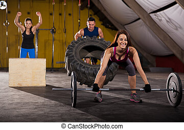 We love crossfit - Happy people working out in a...