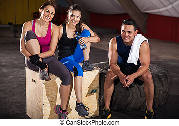 Relaxing at a crossfit gym - Portrait of a group of friends...