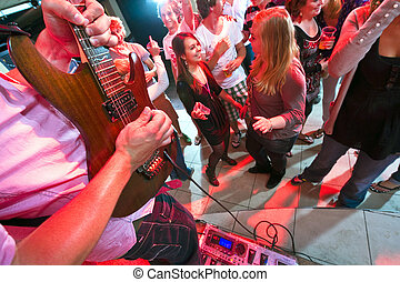 Live music - Guitarist maxing out on his guitar with a large...