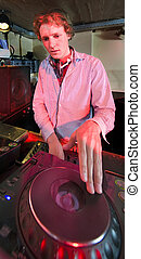 Dee Jay - The DJ at work in a discotheque,