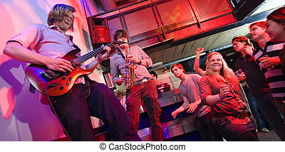 Gig - Guitarist and saxophone player, accompanied by a DJ,...