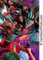 Nightclub - People enjoying themselves in a nightclub with...