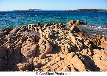Rocks in the clear turquoise water of Costa Smeralda,...