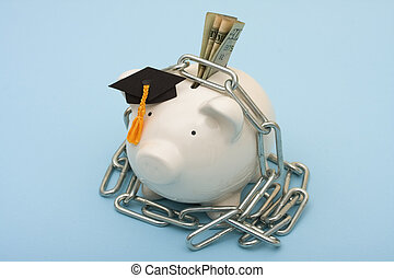 High costs of education - A piggy bank wearing graduation...