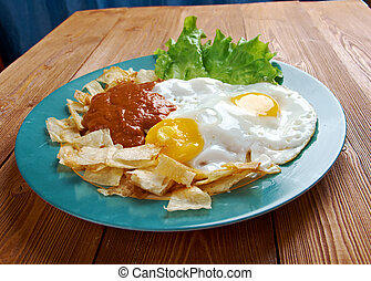 Huevos con chilaquiles - Mexican traditional breakfast eggs...