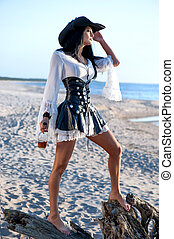 Pirate woman at the beach - Portrait of a pirate woman at...