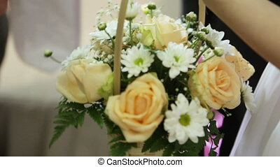 Basket of flowers - Bride give flowers in basket, which she...