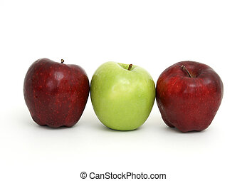 Stuck in the Middle - Three apples with the center one being...