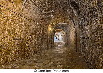 covered alley in Colle di Val d'Elsa, Tuscany, Italy - the...