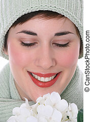 Smiling Female Eyes Closed with White Flowers Closeup