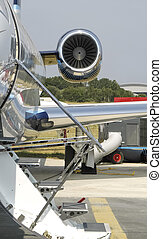 corporate jet - luxury corporate jet at an airport preparing...