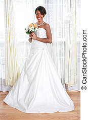 Beautiful Young Bride Standing by Window