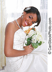 Beautiful Young Bride Sitting by the Window With Bridal Rose...