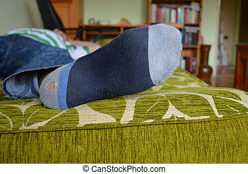 Guys are others - Men's foot in a holey sock