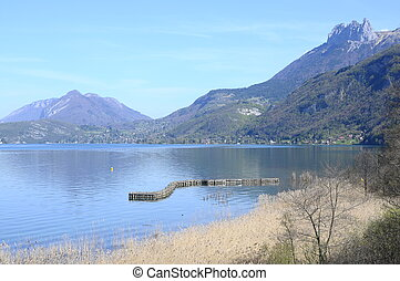 Overview of Annecy lake and Forclaz mountains, in France -...