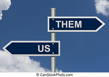 Us versus Them - Blue street signs with blue sky with words...