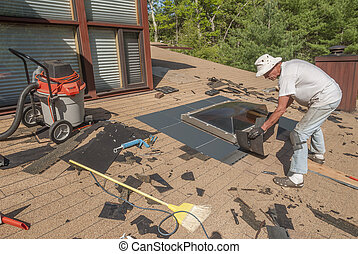 Man repairing roof skylight flashing