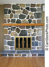 Stone Fireplace - Multi-colored stone fireplace in a room