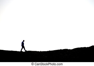 man hiking on a rocky terrain with white background