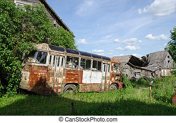 rusty lonely broken bus in country green field - rusty...