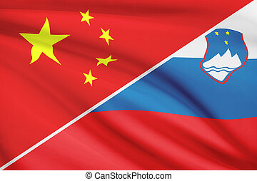Series of ruffled flags. China and Republic of Slovenia. -...