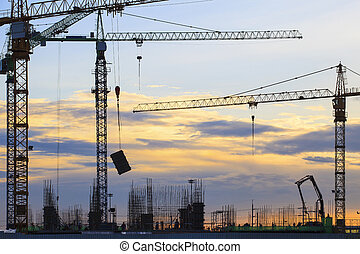 crane of building construction against beautiful dusky sky