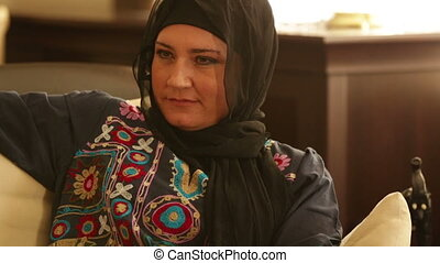 Muslim woman watching tv