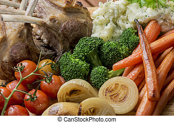 Roast Rack of Lamb with roasted mixed vegetables, onions,...