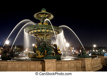 Fountain on Place de la Concorde in Paris at night , France