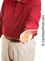 Omega 3 Fish Oil in Hand