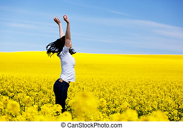 Happy young woman on spring field Success, harmony, health,...