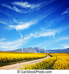 Wind turbines on spring field. Alternative, clean and...