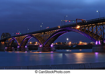 Peace Bridge with purple and gold lights - The Peace Bridge,...