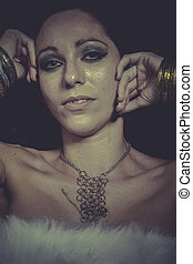 Elegance brunette woman with gold and silver jewelry