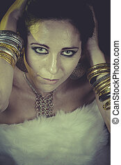 Luxury, brunette woman with gold and silver jewelry