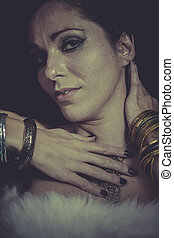 Magic brunette woman with gold and silver jewelry