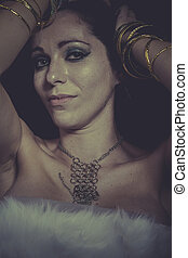 Glamour brunette woman with gold and silver jewelry