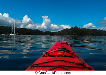Red Kayak on Montague Harbour - A bright red kayak on the...