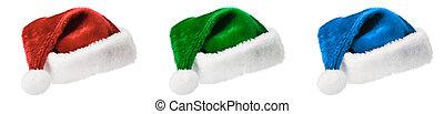 Three Santa hats isolated on white