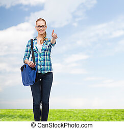 student with laptop bag showing thumbs up