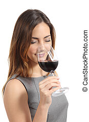 Beautiful sommelier woman tasting wine isolated on a white...