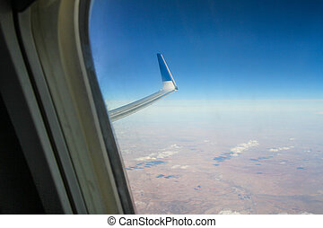 Airplane window - Stock photos - Airplane window with a view...
