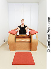 Girl on spa relax massage equipment