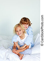Brother embracing her sister in bed - Little brother...