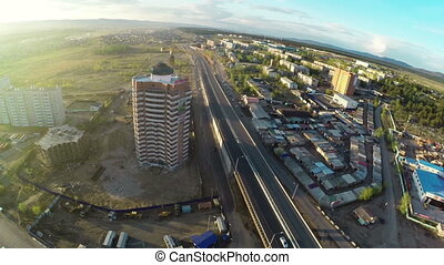 Construction site with crane shot from UAV quadcopter -...