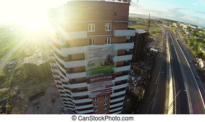 Construction site with crane shot from UAV quadcopter -...