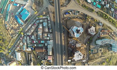 Construction site with crane  and highway shot from UAV quadcopter