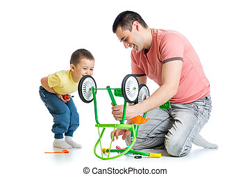 father and son fixing repairing bicycle wheel