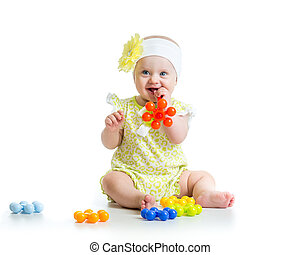 baby girl playing with toys, isolated on white background
